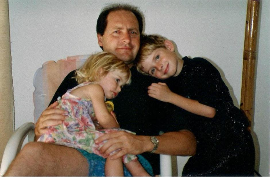 Back in the day: Jon and Tess cuddle up to dad Mike
